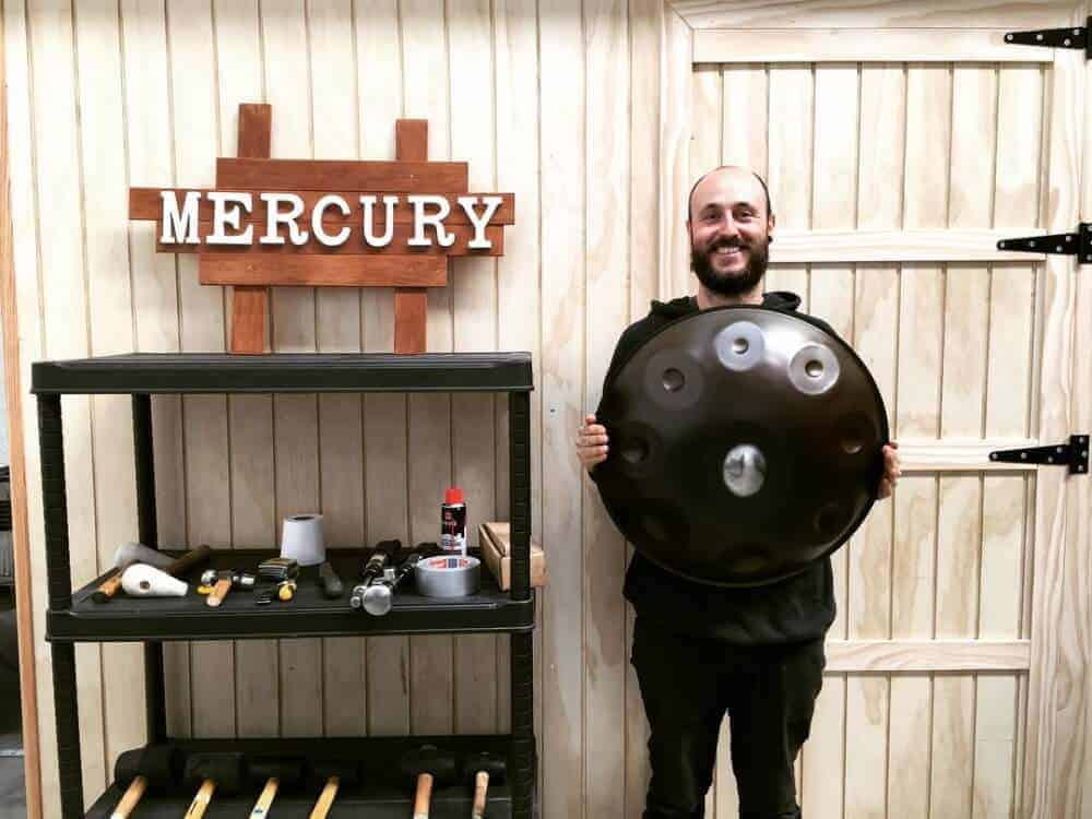 Aitor from Mercury Handpans with logo and handpan